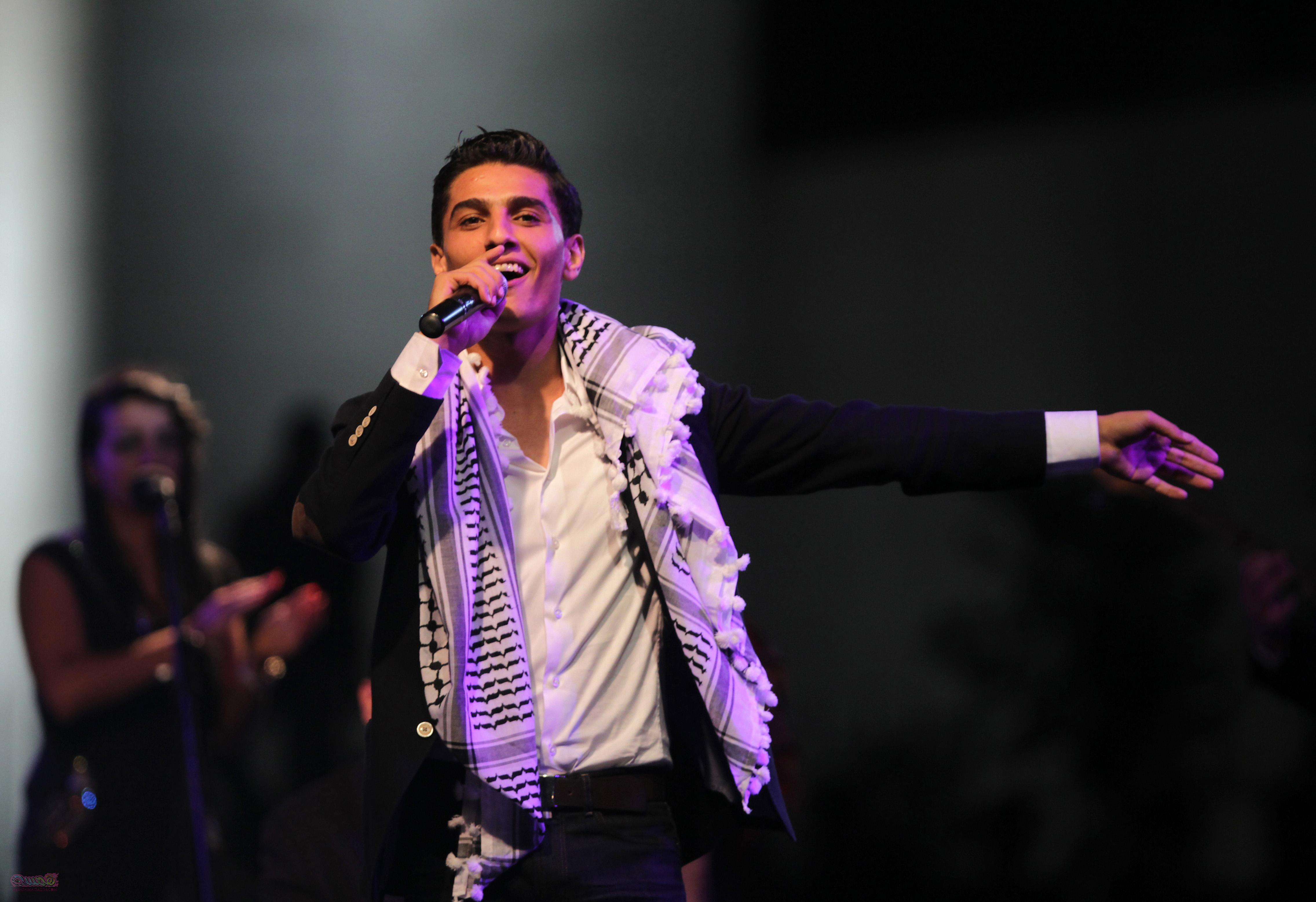 "Palestinian winner of ""Arab Idol"" Mohammed Assaf  performs in the West Bank city of Ramallah  on July 1, 2013. Mohammed Assaf, 22, the Gaza singer who won the prestigious Arab Idol talent contest, holds the celebration concert in Ramallah as part of a three-day West Bank tour. AFP PHOTO/ABBAS MOMANI        (Photo credit should read ABBAS MOMANI/AFP/Getty Images)"